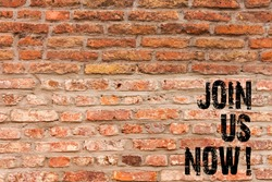 Handwriting text writing Join Us Now. Concept meaning enroll community register website Recruit someone Signup Brick Wall art like Graffiti motivational call written on the wall.