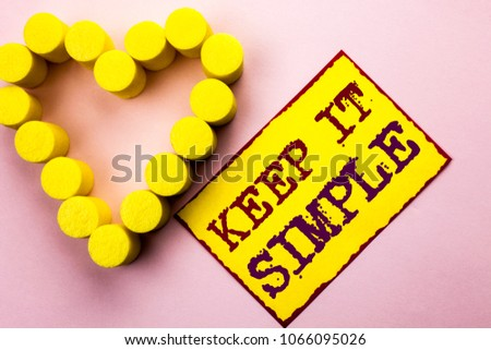 Handwriting text writing Keep It Simple. Concept meaning Simplify Things Easy Understandable Clear Concise Ideas written Yellow Sticky Note Paper Plain background with Heart next to it.