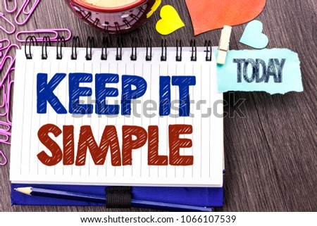 Handwriting text writing Keep It Simple. Concept meaning Simplify Things Easy Understandable Clear Concise Ideas written on Notebook Book on the Wooden background Today Hearts Pins next to it.