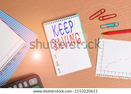 Handwriting text writing Keep Saving. Concept meaning keeping money in an account in a bank or financial organization Striped paperboard notebook cardboard office study supplies chart paper.