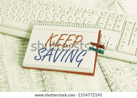 Handwriting text writing Keep Saving. Concept meaning keeping money in an account in a bank or financial organization notebook paper reminder clothespin pinned sheet white keyboard light wooden.