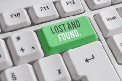 Handwriting text writing Lost And Found. Concept meaning a place where lost items are stored until they reclaimed White pc keyboard with empty note paper above white background key copy space.