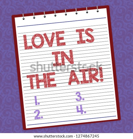 Handwriting text writing Love Is In The Air. Concept meaning Roanalysistic emotions situations new couple relationships Lined Spiral Top Color Notepad photo on Watermark Printed Background.