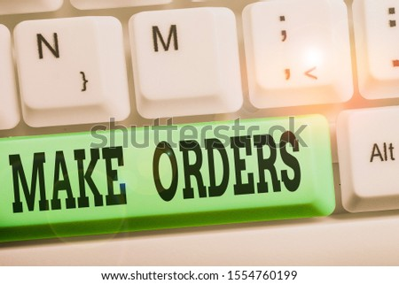 Handwriting text writing Make Orders. Concept meaning A confirmed request by one party to another to buy or sell White pc keyboard with empty note paper above white background key copy space.