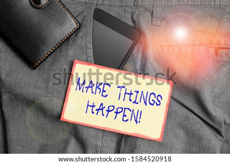Handwriting text writing Make Things Happen. Concept meaning you will have to make hard efforts in order to achieve it Smartphone device inside trousers front pocket with wallet and note paper.