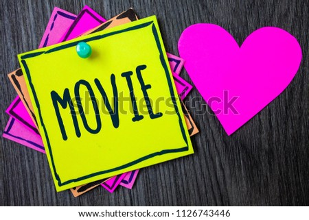 Handwriting text writing Movie. Concept meaning Cinema or television film Motion picture Video displayed on screen Border sticky remember cards love heart pinned dark woody background. #1126743446