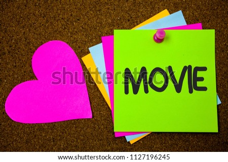 Handwriting text writing Movie. Concept meaning Cinema or television film Motion picture Video displayed on screen Thumb pinned sticky cards love heart messages card remember sign board. #1127196245