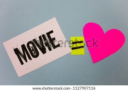 Handwriting text writing Movie. Concept meaning Cinema or television film Motion picture Video displayed on screen Equal symbol sticky notes heart love plane coloured background calculation. #1127907116
