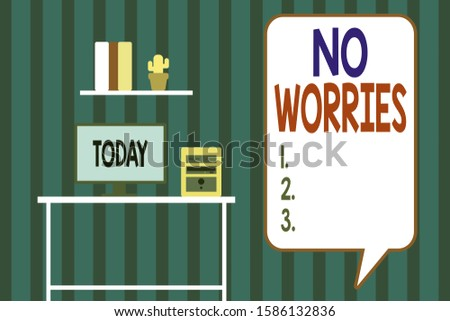 Handwriting text writing No Worries. Concept meaning an expression used to say that everything is all right Desktop computer wooden table background shelf books flower pot ornaments.