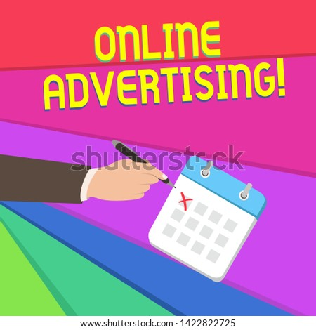 Handwriting text writing Online Advertising. Concept meaning Internet Web Marketing to Promote Products and Services Male Hand Formal Suit Crosses Off One Day Calendar Red Ink Ballpoint Pen.