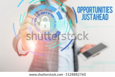 Handwriting text writing Opportunities Just Ahead. Concept meaning Advantageous circumstances Perseverance pays off Female human wear formal work suit presenting presentation use smart device.