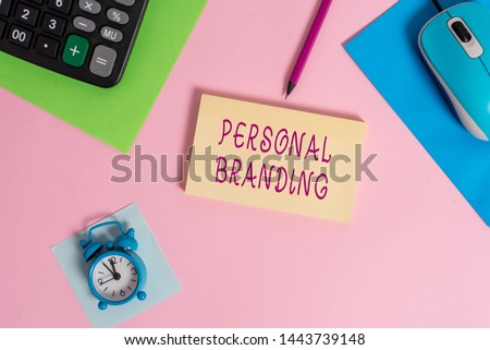 Handwriting text writing Personal Branding. Concept meaning Practice of People Marketing themselves Image as Brands Mouse calculator sheets marker notepad alarm clock colored background.