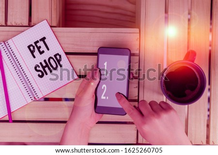 Handwriting text writing Pet Shop. Concept meaning Retail business that sells different kinds of animals to the public woman computer smartphone drink mug office supplies technological devices.