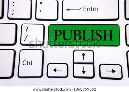 Handwriting text writing Publish. Concept meaning Make information available to people Issue a written product written on Green Key Button on White Keyboard with copy space. Top view. #1068959552