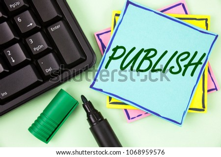 Handwriting text writing Publish. Concept meaning Make information available to people Issue a written product written on Sticky Note paper on plain Green background Marker and Keyboard. #1068959576