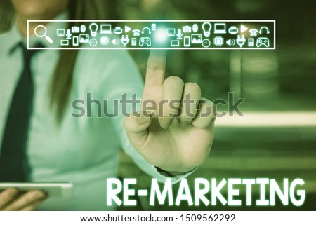 Handwriting text writing Re Marketing. Concept meaning Strategy to reach potential customers in your website Woman wear formal work suit presenting presentation using smart device.