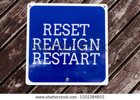 Handwriting text writing Reset Realign Restart. Concept meaning Life audit will help you put things in perspectives Empty blue board with copy space above wooden background.
