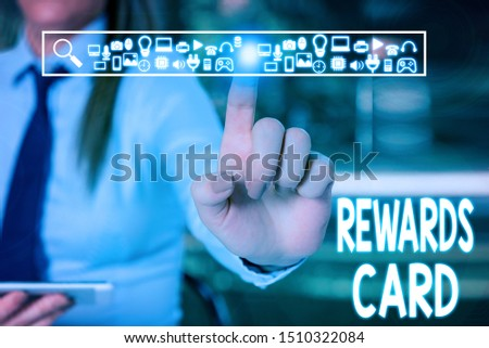 Handwriting text writing Rewards Card. Concept meaning Help earn cash points miles from everyday purchase Incentives Woman wear formal work suit presenting presentation using smart device. #1510322084
