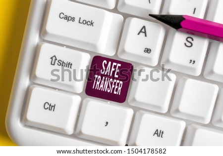 Handwriting text writing Safe Transfer. Concept meaning Wire Transfers electronically Not paper based Transaction White pc keyboard with empty note paper above white background key copy space. #1504178582