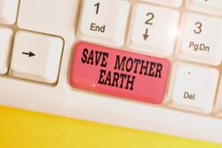 Handwriting text writing Save Mother Earth. Concept meaning doing small actions prevent wasting water heat energy White pc keyboard with empty note paper above white background key copy space.