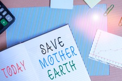 Handwriting text writing Save Mother Earth. Concept meaning doing small actions prevent wasting water heat energy Striped paperboard notebook cardboard office study supplies chart paper.