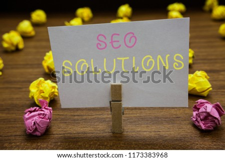 Handwriting text writing Seo Solutions. Concept meaning Search Engine Result Page Increase Visitors by Rankings Clothespin holding white paper note crumpled papers several tries mistakes. #1173383968