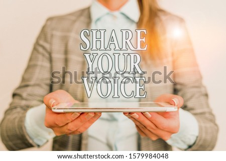 Handwriting text writing Share Your Voice. Concept meaning asking employee or member to give his opinion or suggestion Business concept with mobile phone and business woman.