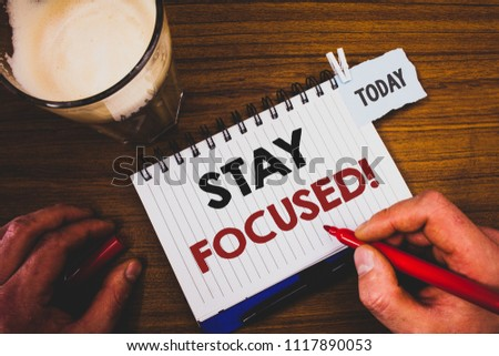 Handwriting text writing Stay Focused Motivational Call. Concept meaning Maintain Focus Inspirational Thinking #1117890053