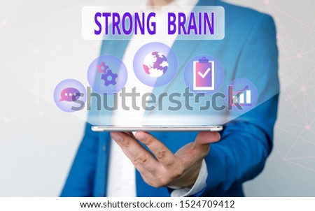 Handwriting text writing Strong Brain. Concept meaning own firm attitudes and opinions and are not easily influenced Male human wear formal work suit presenting presentation using smart device.