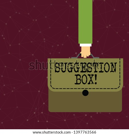 Handwriting text writing Suggestion Box. Concept meaning container which showing can leave comments about something Businessman Hand Carrying Colorful Briefcase Portfolio with Stitch Applique.