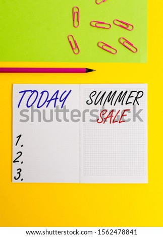 Handwriting text writing Summer Sale. Concept meaning time when a store sells products at much lower prices than usual Blank squared notebook pencil marker paper sheet plain colored background.