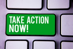 Handwriting text writing Take Action Now Motivational Call. Concept meaning Urgent Move Start Promptly Immediate Begin White Text two words green tab key button press computer keyboard work.
