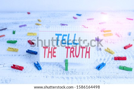 Handwriting text writing Tell The Truth. Concept meaning Confess some demonstratingal fact that someone wants keeps hidden Green clothespin white wood background colored paper reminder office supply.