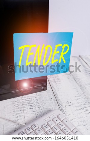 Handwriting text writing Tender. Concept meaning showing gentleness kindness and affection sensitive to pain Notation paper taped to black computer monitor screen near white keyboard.