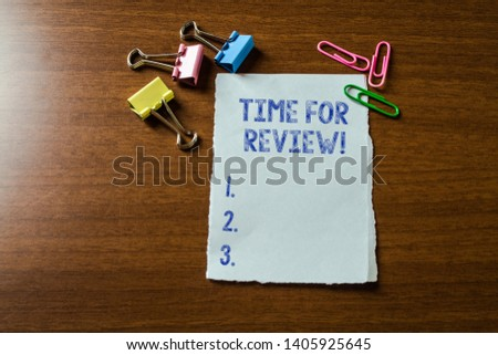 Handwriting text writing Time For Review. Concept meaning formal assessment of something with intention instituting change Blank stationary paper set three colored clips binders lying wooden table. #1405925645