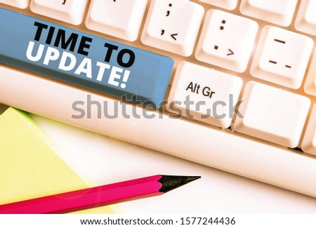 Handwriting text writing Time To Update. Concept meaning act updating something someone or updated version program White pc keyboard with empty note paper above white background key copy space. #1577244436