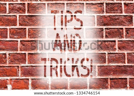 Handwriting text writing Tips And Tricks. Concept meaning Suggestions to Make things easier Helpful Advices Solutions Brick Wall art like Graffiti motivational call written on the wall.