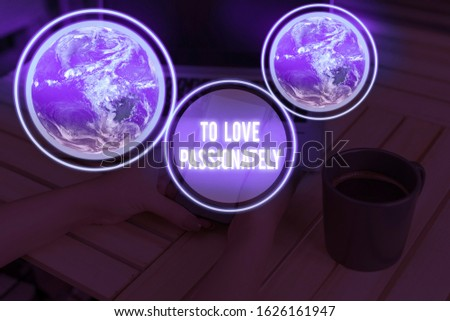 Handwriting text writing To Love Passionately. Concept meaning Strong feeling for someone or something else Affection Elements of this image furnished by NASA.