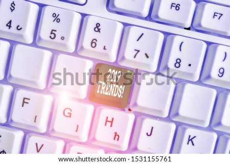 Handwriting text writing 2019 Trends. Concept meaning general direction in which something is developing or changing White pc keyboard with empty note paper above white background key copy space.