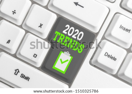 Handwriting text writing 2020 Trends. Concept meaning things that is famous for short period of time in current year White pc keyboard with empty note paper above white background key copy space.