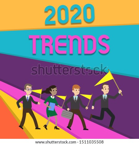 Handwriting text writing 2020 Trends. Concept meaning things that is famous for short period of time in current year People Crowd Flags Pennants Headed by Leader Running Demonstration Meeting.