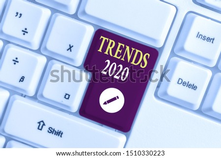 Handwriting text writing Trends 2020. Concept meaning Upcoming year prevailing tendency Widely Discussed Online White pc keyboard with empty note paper above white background key copy space.