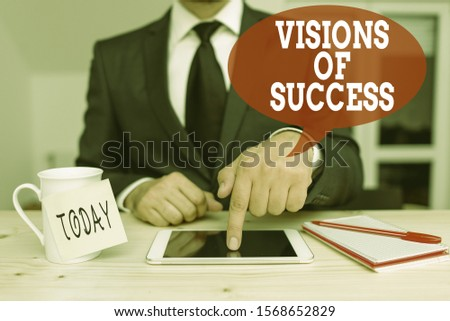 Handwriting text writing Visions Of Success. Concept meaning Clear End Result of Purpose Goal Perspective Plan Male human wear formal clothes present presentation use hi tech smartphone.