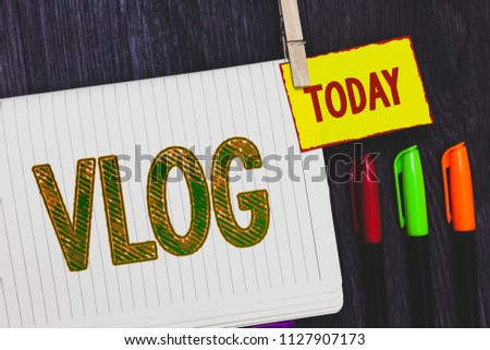 Handwriting text writing Vlog. Concept meaning Entertaining multimedia self broadcasting news reporting stories Papers marker pens nice art daily creative work wood colour black shadow.