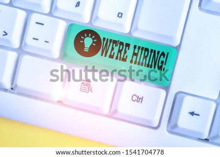 Handwriting text writing We Re Hiring. Concept meaning recently employ someone or pay him to do particular job White pc keyboard with empty note paper above white background key copy space.