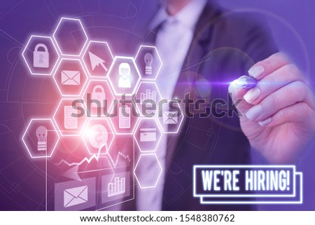 Handwriting text writing We Re Hiring. Concept meaning recently employ someone or pay him to do particular job Woman wear formal work suit present presentation using smart latest device.