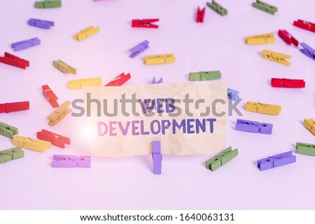 Handwriting text writing Web Development. Concept meaning dealing with developing websites for hosting via intranet Colored clothespin papers empty reminder white floor background office.