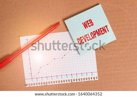 Handwriting text writing Web Development. Concept meaning dealing with developing websites for hosting via intranet Desk notebook paper office cardboard paperboard study supplies table chart.