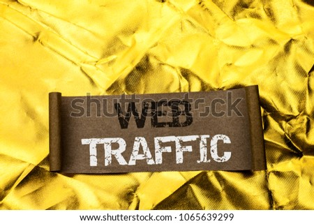 Handwriting text writing Web Traffic. Concept meaning Internet Boost Visitors Audience Visits Customers Viewers written on Cardboard Piece on the Golden textured background. #1065639299