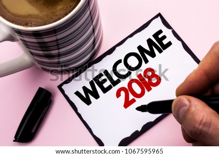 Handwriting text writing Welcome 2018. Concept meaning Celebration New Celebrate Future Wishes Gratifying Wish written by Man on Sticky Note paper holding Marker plain background Coffee Cup #1067595965